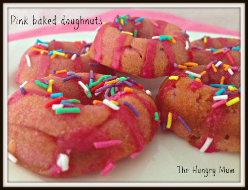 Pink baked doughnuts